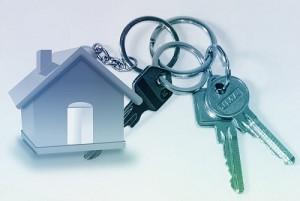 Immobilien-Schulden Schlüssebund mit Haus