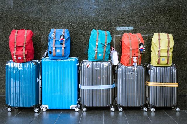 Koffer auswandern mit Schulden